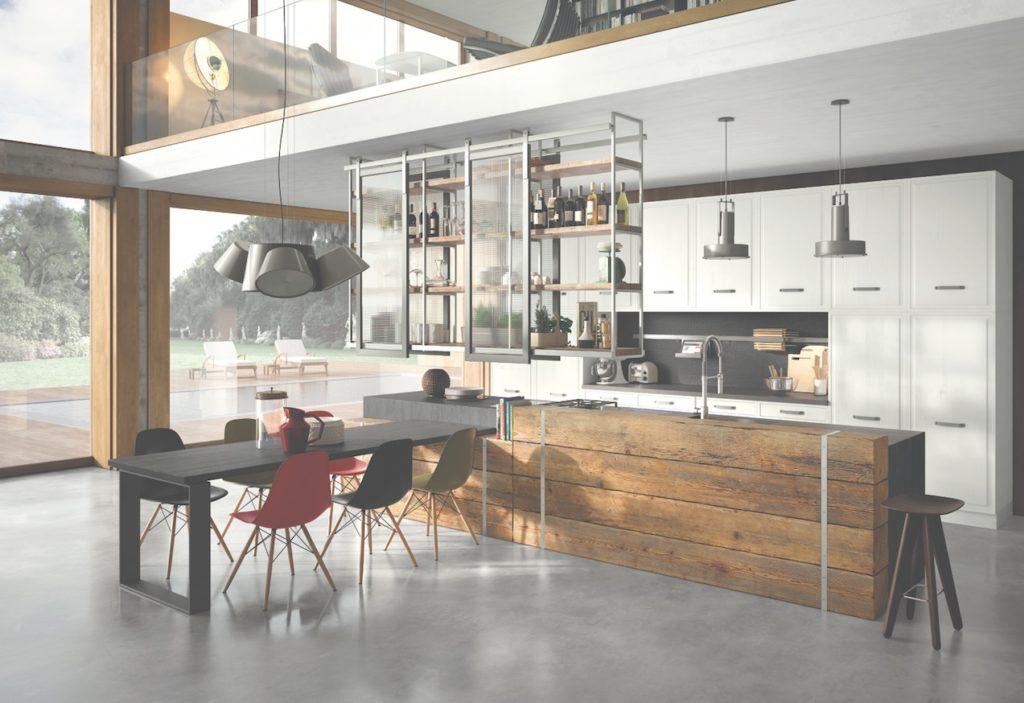 Citazioni industriali e contrasti materici convivono nella cucina Brera 76, realizzata in legno massello e disponibile nelle tre varianti cromatiche: bianco, rosso e antracite